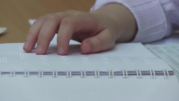 Thumbnail for Blind Girl Reading Braille