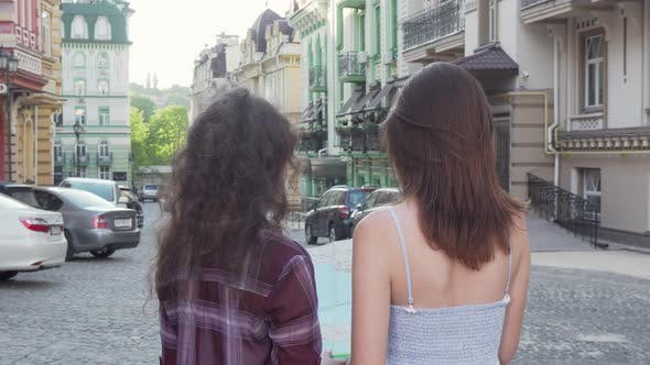 Thumbnail for Cheerful Female Friends Smiling To the Camera While Wandering in the City