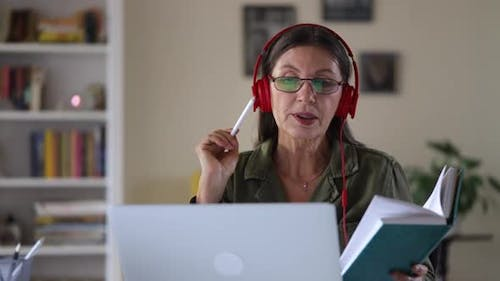 Old Mature Woman Teacher Teaching Online Video Lesson on Laptop at Home Spbi