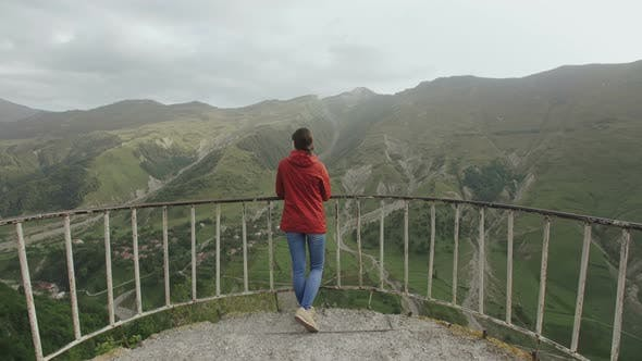 Thumbnail for Woman Traveler on Observation Platform the View of the Mountain Valley with a Gorge