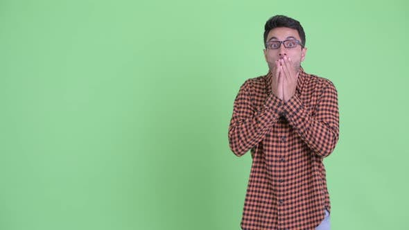 Thumbnail for Young Hispanic Hipster Man Showing Something and Looking Shocked