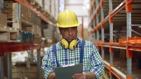 Thumbnail for Factory Worker Walking in Warehouse with Clipboard