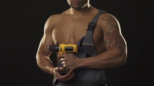Thumbnail for Cropped Shot of a Musuclar Sexy Shirtless Ripped Repairman Holding a Drill