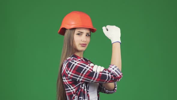 Thumbnail for Confident Sexy Female Constructionist Showing Her Biceps We Can Do It Gesture