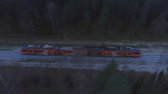 Thumbnail for Aerial Footage of Passing Train at Night