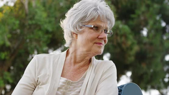 Elderly woman getting lost in thought