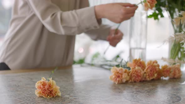Sequence of Female Florist Arranging Carnations into Bouquet