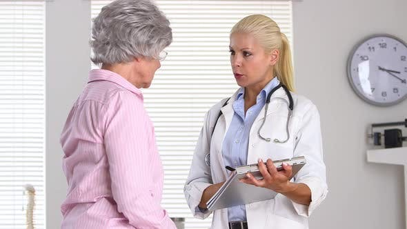 Thumbnail for Patient explaining problem to doctor and indicating mouth