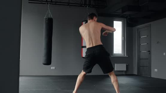 Mixed Martial Art Fighter Does Shadow Boxing and Trains at Fighter Club Fighter Man is Fighting with