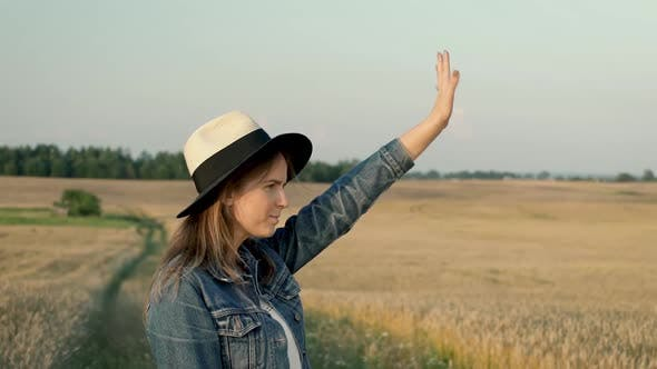 Young Woman Waving Hand For Somebody