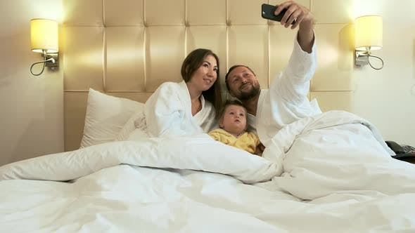 Thumbnail for Happy Family in Bed Preparing for Bed in the Evening