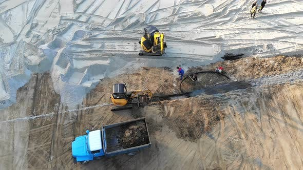 Thumbnail for Aerial View Machinery on a Construction Site. Construction Work with the Help of Tractors and Other