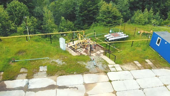 Thumbnail for Aerial View A Small Gas Production Site Located in a Mountainous Area Surrounded By Green Forest