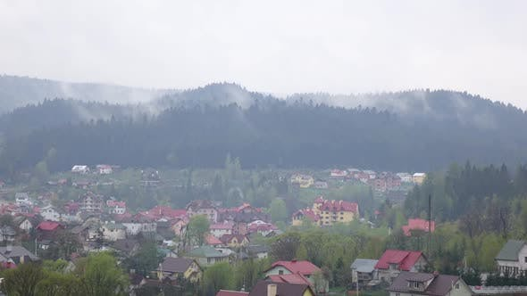 Thumbnail for Time Lapse of Cloudy Morning in Small Town in Mountains
