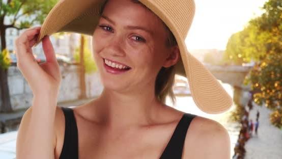 Thumbnail for Close up portrait pretty Caucasian girl in Paris wearing sunhat