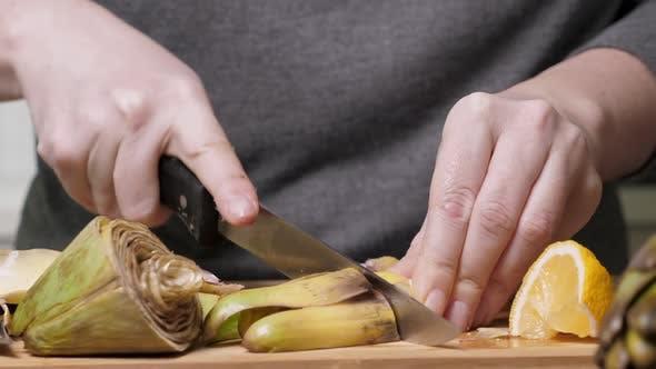 Thumbnail for Woman Cut Artichoke