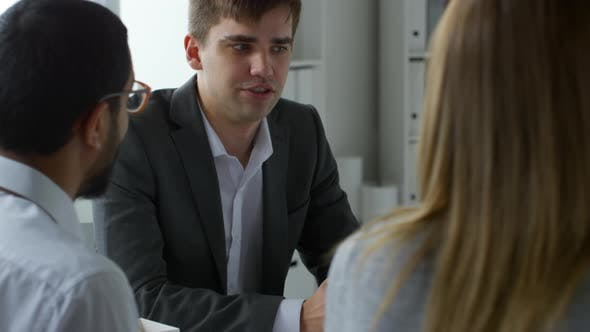 Thumbnail for Caucasian Businessman Talking with Coworkers in Office