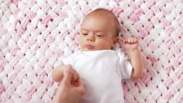 Thumbnail for Sweet Baby Girl Lying on Knitted Plush Blanket