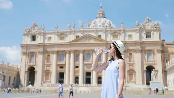 Thumbnail for Young Woman Drinking Water in Hot Day Background at St Peter's Basilica Church in Vatican City