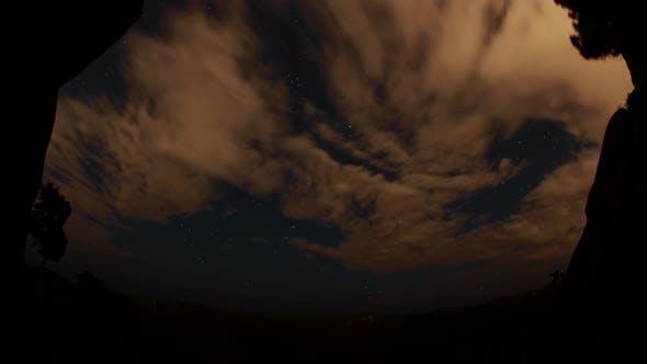 Thumbnail for Timelapse of the Starry Sky Above the Mountain Peaks in the Siberian Forest. Krasnoyarsk Nature