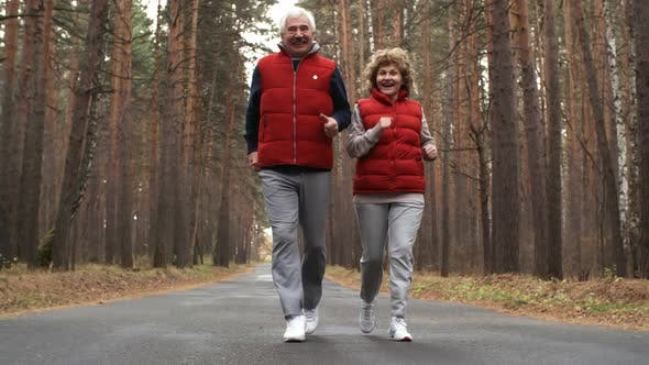 Thumbnail for Aged Couple Running in Forest