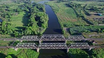 Railroad Bridge and River at Beautiful Sunlight in Summer