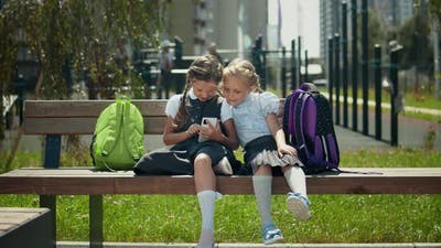 Kids Playing With Mobile Phone At School Break