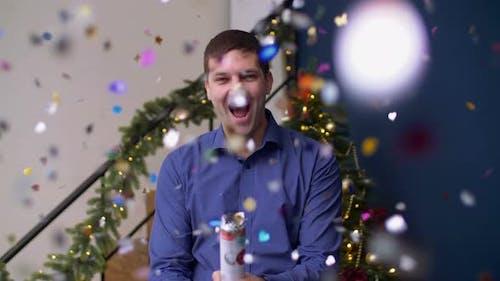 Ecstatic Man Exploding Christmas Confetti Cracker