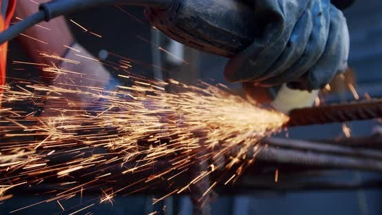 Thumbnail for Close-up Slow Motion. Side View of Male Hands Cutting Metal with Grinding Machine.