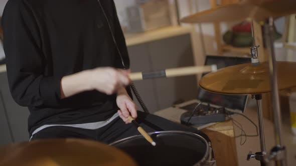 Thumbnail for Guy In Headphones Playing Drums