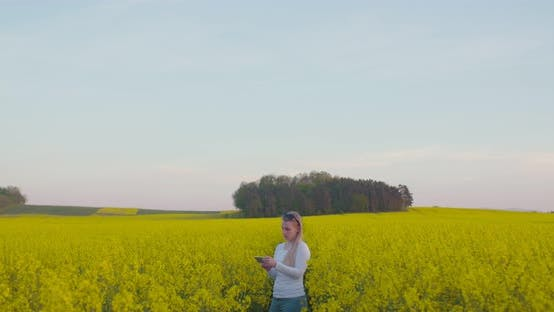 Thumbnail for Young Farmer Using Digital Tablet at Oilseed Rape Field