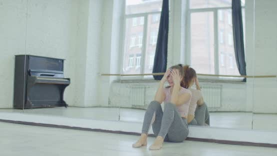 Thumbnail for Crying Female Dancer Leaning on Mirror in Studio