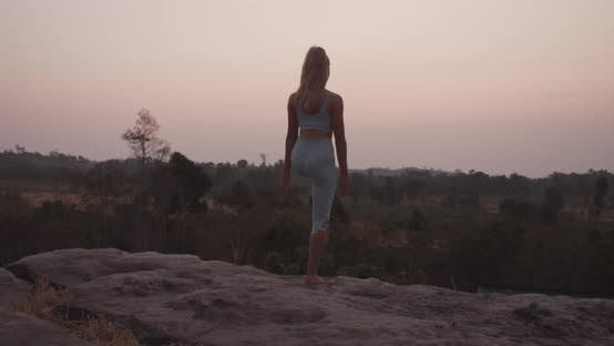 Thumbnail for Fit Female Model Standing on One Foot By the Rocks Doing Yoga