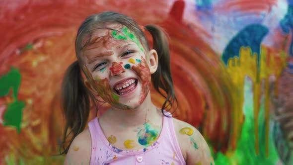 Thumbnail for Little Girl Child Preschooler Draws Hands Paints On White Wall
