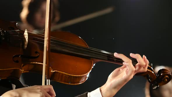 Thumbnail for Women Bows Over the Strings of a Violin in a Room