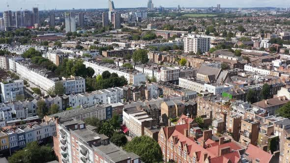 Forwards Fly Above Rows of Houses in Urban Neighbourhood