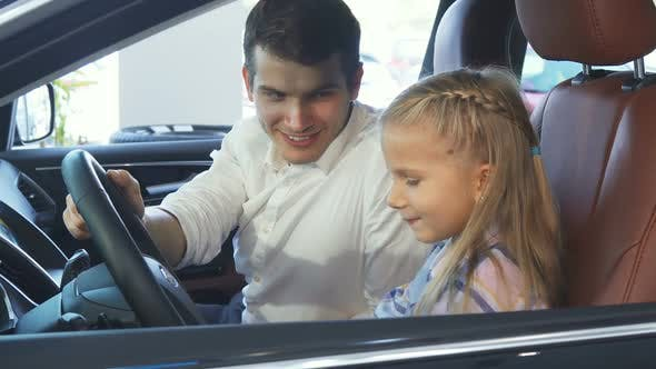 Thumbnail for Little Daughter and Father Sit in the Car and Talk