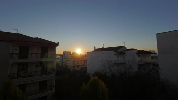 Thumbnail for Timelapse of Sun Rising in Small Town