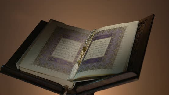 Thumbnail for Holy Quran On Book Rest With Prayer Beads 3