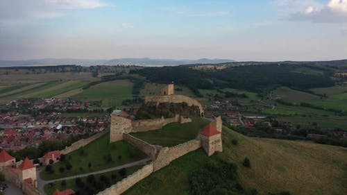Medieval Castle Surrounded By Romanian Village
