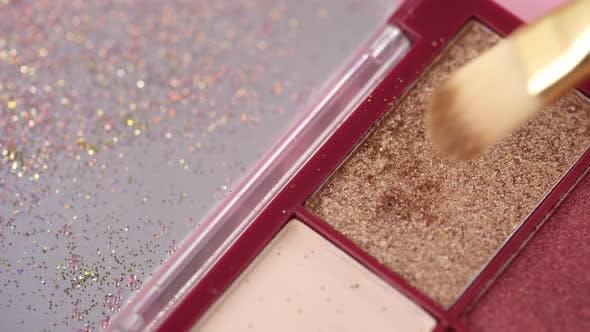 Thumbnail for Picking Up Metallic Glittering Eyeshadow with Brush