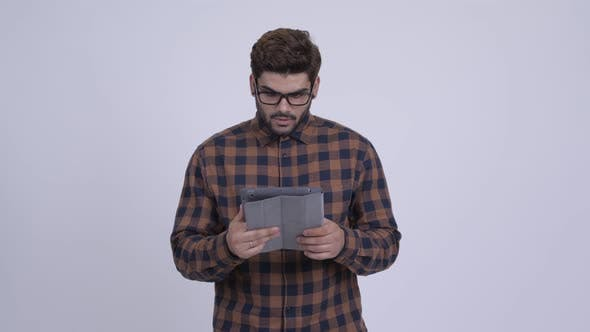 Thumbnail for Happy Young Indian Hipster Man Using Digital Tablet and Getting Good News