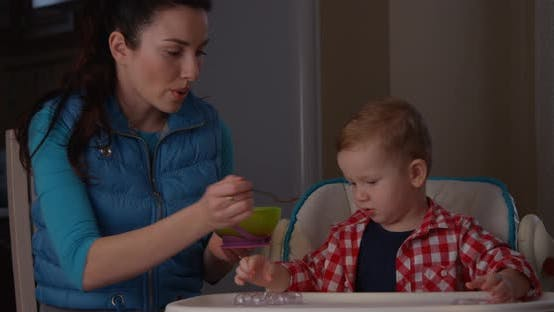 Thumbnail for Little Boy Does Not Want To Eat Breakfast And Crying Mother Trying To Feed Child shot on RED