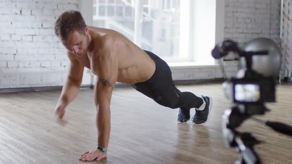 Thumbnail for Shirtless Male Coach Explaining How to Do Push-Ups on Camera