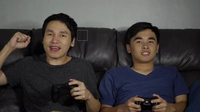 two man playing video games and wins