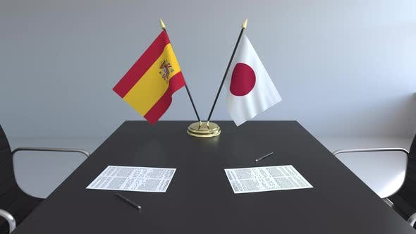 Flags of Spain and Japan and Papers on the Table