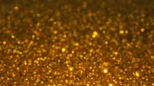 Gold glitter background with sparkling texture.