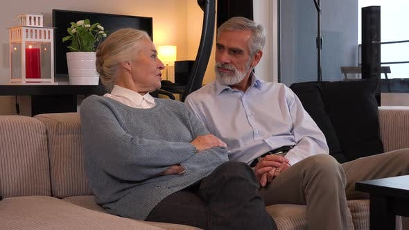 Thumbnail for An Elderly Couple Sits on A Couch in An Apartment and Talks