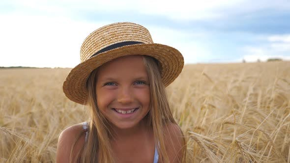 Thumbnail for Portrait of Happy Laughing Kid with Blonde Hair in the Wheat Meadow, Beautiful Smiling Girl in Straw