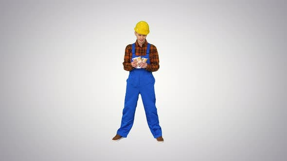Cover Image for A Workman Counting Cash in Exaggerated Way and Dancing After That on Gradient Background.
